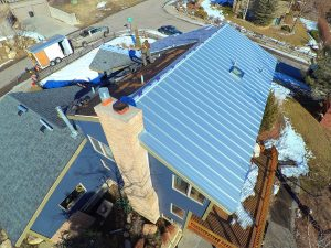 Installing a metal roof on a home in Billings